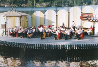 Newmarket Citizens Band in Concert on the barge at Gull Lake in Gravenhurst